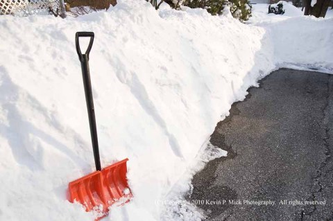 Snow shovel in driveway