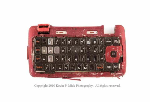 Broken red cell phone keyboard
