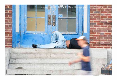 Person experiencing homelessness and runner