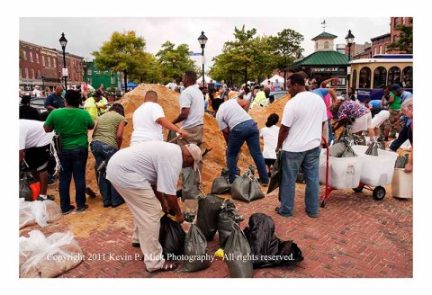 People filling sandbags in Fells Point prior to Irene