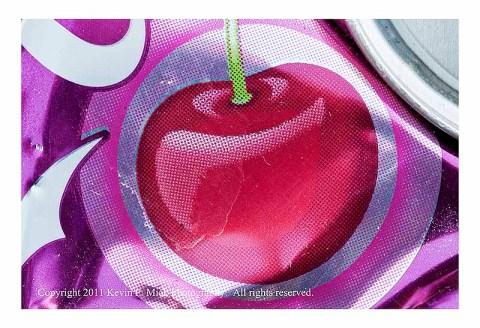 Closeup photograph of a cherry Coke can