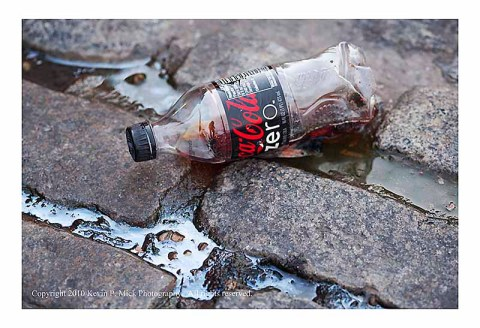 Coke Zero bottle in street