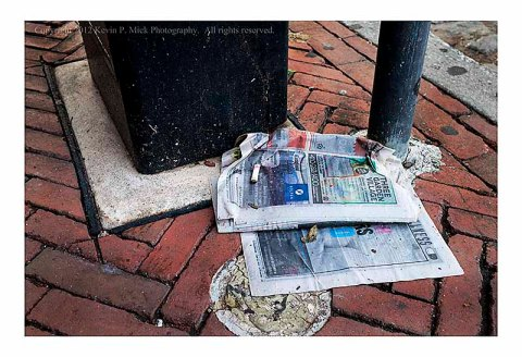 City paper in street