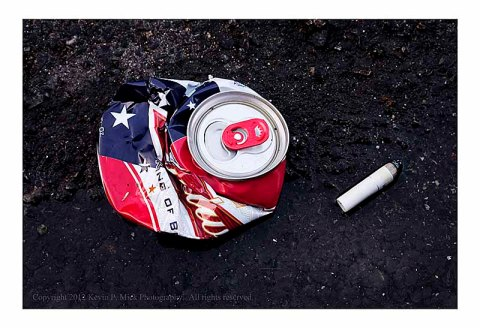 Crushed Budweiser can in street