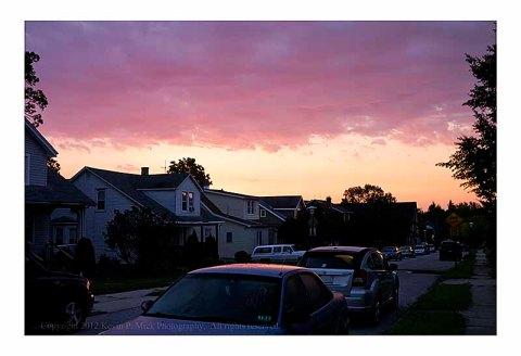 Sun rising over Baltimore neighborhood