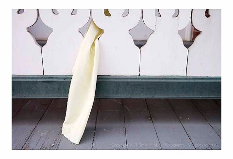 Yellow ribbon hanging from railing