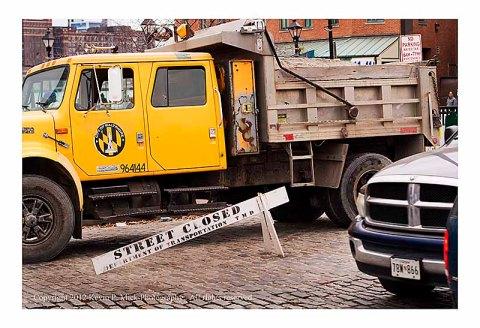 Truck delivering sand for bagging