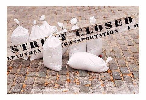 Sandbags near Street Closed sign