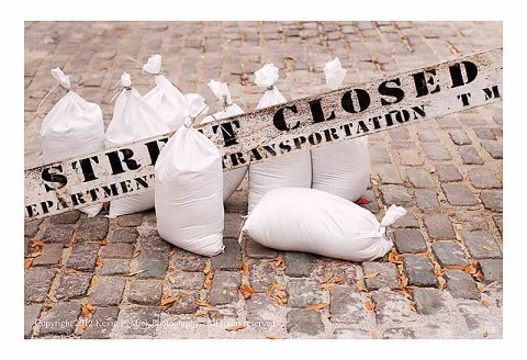 Sandbags near Street Closed sign