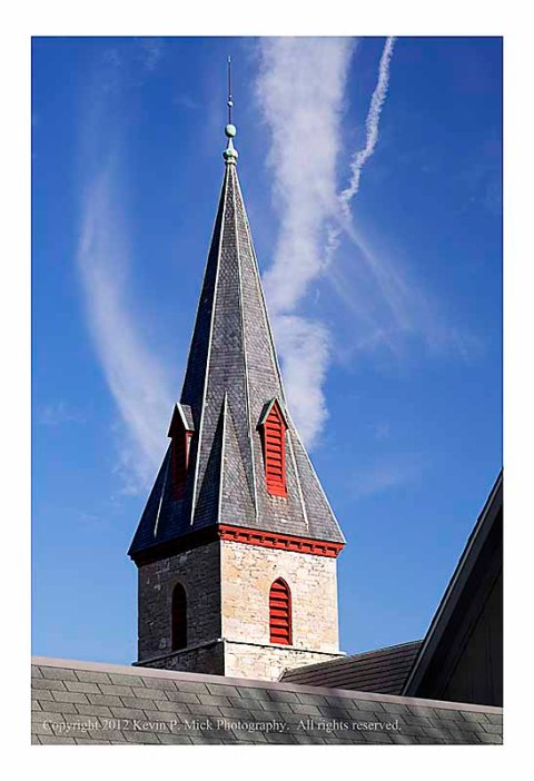 Church steeple and contrails