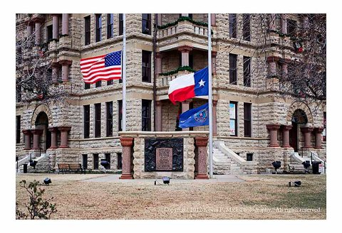 United States and Texas state flags at half-mast