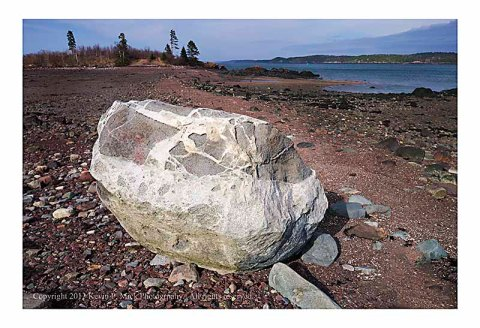 Large rock on beach in Perry, Maine.