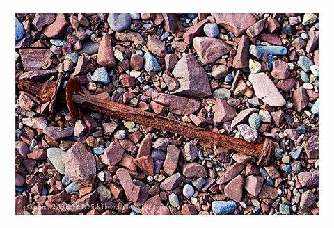 Rusted bolt on beach.