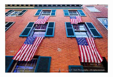 American flags draped from windows.