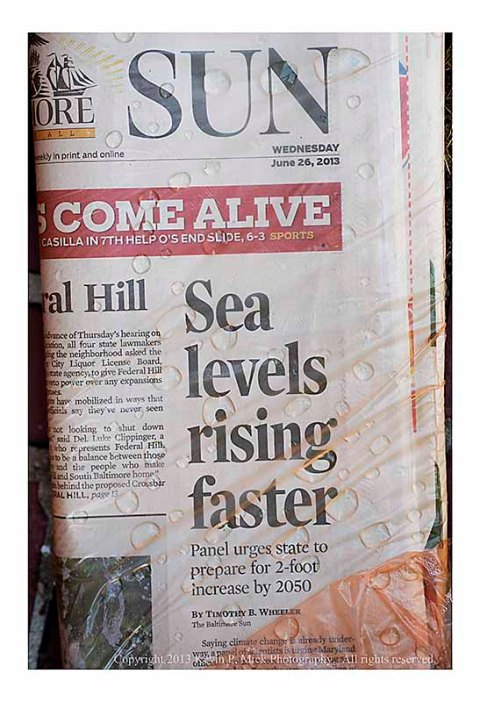 Front page of Sunpaper advising about sea level change.