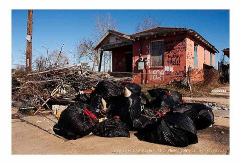 Trash outside house in Lower 9 Ward three years after Katrina.