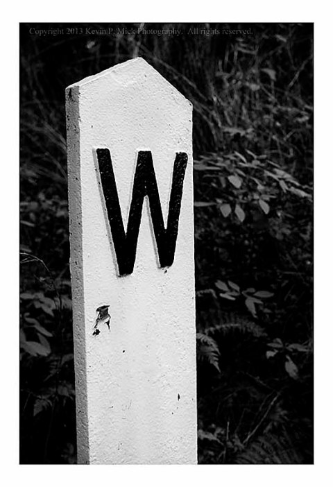 Mile marker on old railroad trail.