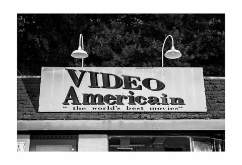 "The Video Americain sign advertising ""the world's best movies""."