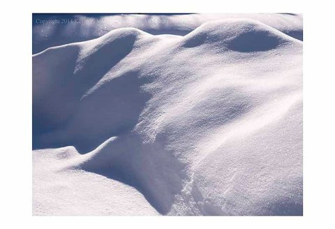 Snow mounds with shadows and highlights.