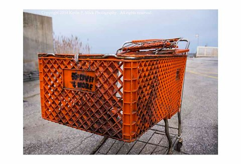 An abandoned shopping cart by the bay in Ocean City, Maryland.