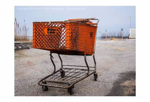An abandoned shopping cart by the bay in Ocean City, Maryland-looking from the front.
