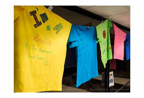 Clothesline Project T-Shirts hung from ceiling.