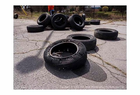 Ripped tire that has been abandoned.