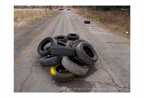 Piles of abandoned tires laying in the road.