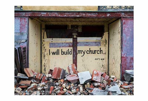 Bible quote in the burned out Bible Community Mission rubble.