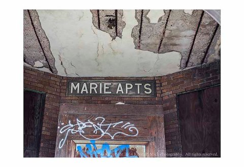 Marie Apts. building, entryway and masthead view, in its abandoned state.