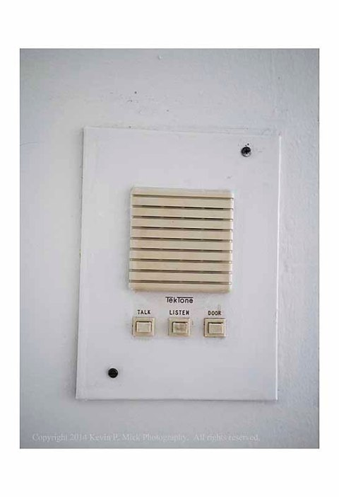 Wall-mounted intercom unit in old apartment.