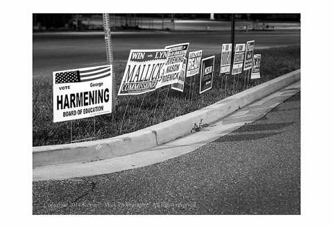 BW photo of campaign signs for local offices.