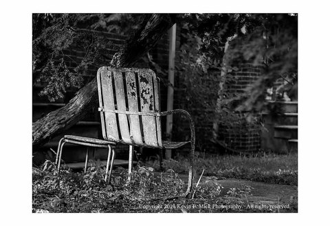 BW photograph of a rusty chair.