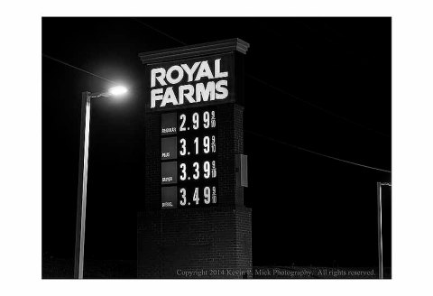 BW photograph of a Royal Farms gasoline prices sign advertising $2.99/gal gasoline.