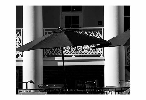 BW photo of restaurant umbrellas.