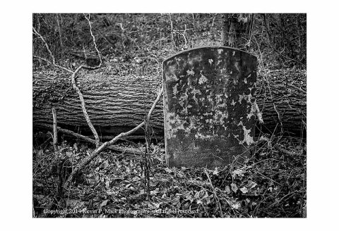 BW photograph of a headstone.