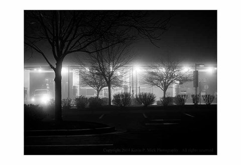 BW photograph of a gas station early on a foggy morning.