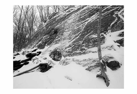 BW photograph of a rock wall at Morgan Run after a light snow.
