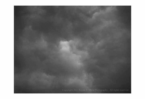 BW photograph of storm clouds.