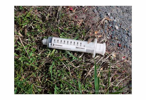 Syringe lying beside the road
