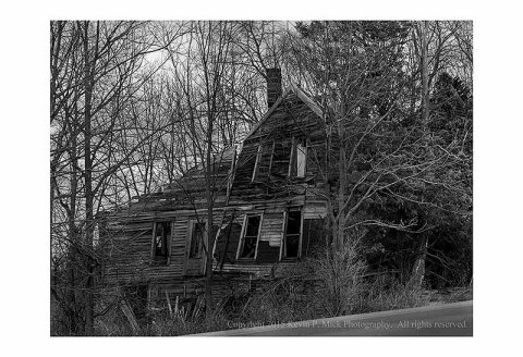 BW photograph of a collapsed house