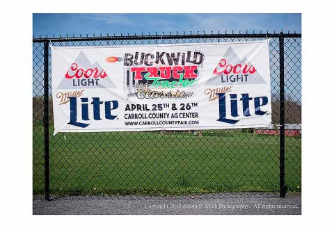 "Banner advertising ""Buckwild Truck and Tractor Classic"" sponsored by beer companies"