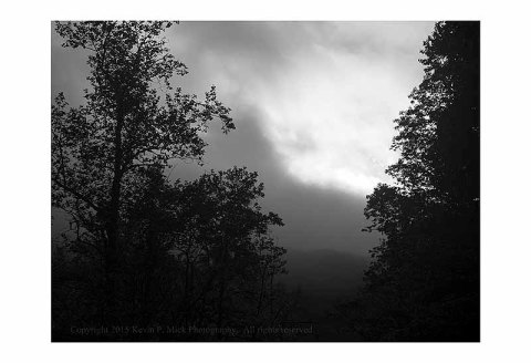 BW photograph of an incoming storm in the mountains