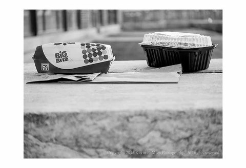 BW photograph of two food containers left behind after July 4th