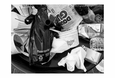 BW photograph of a bag in trash advertising 'recyclable'