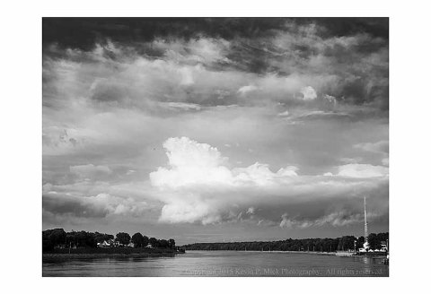 BW photograph of clouds over the Chesapeake City Canal