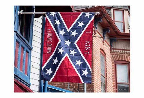 "The Confederate Stars and Bars battle flag with ""I Aint Coming Down"" added"