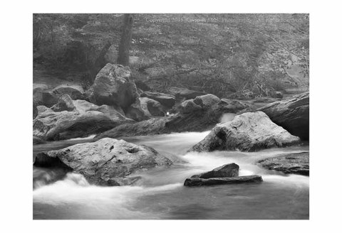 BW photography of Morgan Run streaming through rocks on a foggy morning