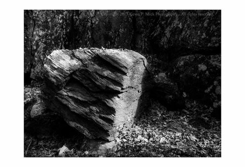 BW photograph of a side-lit boulder
