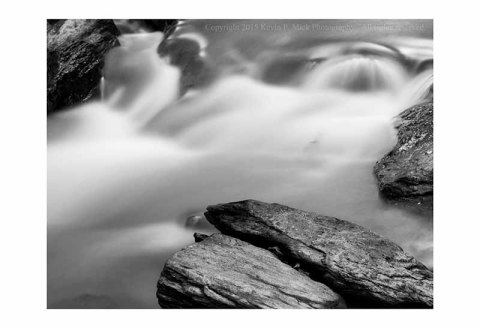 BW photograph of running water at Morgan Run